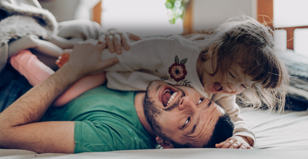 Dad with his daughter laughing